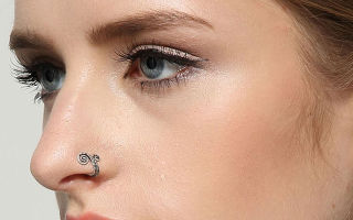 Пирсинг крыла носа: особенности процедуры и виды украшений